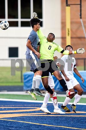 Kilgore's Kaleb Jett(0) jumps to protect the goal during a high school soccer playoff game at Brook Hill Herrington Stadium in Bullard, Texas, on Tuesday, April 4, 2017. (Chelsea Purgahn/Tyler Morning Telegraph)
