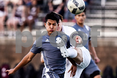 Palestine's Javier Leonor reacts as Kilgore's Jesus Gonzalez kicks the ball during a high school soccer playoff game at Brook Hill Herrington Stadium in Bullard, Texas, on Tuesday, April 4, 2017. (Chelsea Purgahn/Tyler Morning Telegraph)