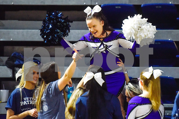 Valerie Bloomquist smiles as other cheerleaders hold her up during the Special Olympics at the University of Texas at Tyler in Tyler, Texas, on Wednesday, April 4, 2018. Hundreds of people attended the event, which included a number of different sports games before basketball games between UT Tyler athletes and Special Olympic athletes. (Chelsea Purgahn/Tyler Morning Telegraph)