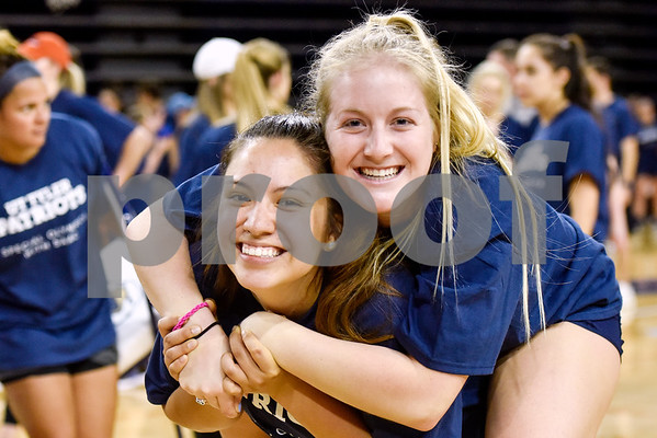 Reighanna Guzman and Makenna Bartlett pose for a photo during the Special Olympics at the University of Texas at Tyler in Tyler, Texas, on Wednesday, April 4, 2018. Hundreds of people attended the event, which included a number of different sports games before basketball games between UT Tyler athletes and Special Olympic athletes. (Chelsea Purgahn/Tyler Morning Telegraph)