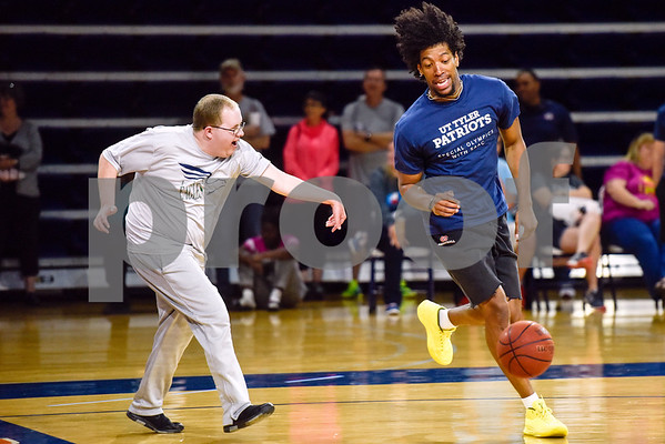Bryan Sanders guards Xavier Fogle as Fogle dribbles the ball down the court during the Special Olympics at the University of Texas at Tyler in Tyler, Texas, on Wednesday, April 4, 2018. Hundreds of people attended the event, which included a number of different sports games before basketball games between UT Tyler athletes and Special Olympic athletes. (Chelsea Purgahn/Tyler Morning Telegraph)
