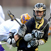 Monarch's Tim Metzger (right) gets jammed by Boulder's Logan Bock (left) during their lacrosse game at Recht Field in Boulder, Colorado April 5, 2012. CAMERA/MARK LEFFINGWELL