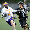 Monarch's Tim Metzger (right) gets past Boulder's Logan Brock to score during their lacrosse game at Recht Field in Boulder, Colorado April 5, 2012. CAMERA/MARK LEFFINGWELL