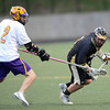 Boulder's Sam Hager (left) and Monarch's Jordan Meehan (right) race for the ball during their lacrosse game at Recht Field in Boulder, Colorado April 5, 2012. CAMERA/MARK LEFFINGWELL