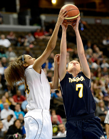 Blue's Andi Houck (right), Centaurus, and White's Katie Edwards (left), Legacy, go for a rebound during The Show Colorado's High School All-Star Game in Denver, Colorado April 5, 2012. CAMERA/MARK LEFFINGWELL