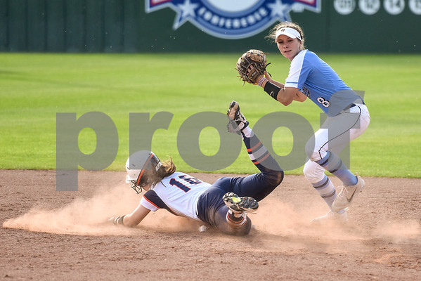 UT Tyler's Shea Smith (16) slides to second base but is out as East Texas Baptist University's Linzie Lewis (8) throws the ball to first base during a college softball game at the University of Texas at Tyler in Tyler, Texas, on Friday, April 6, 2018. (Chelsea Purgahn/Tyler Morning Telegraph)