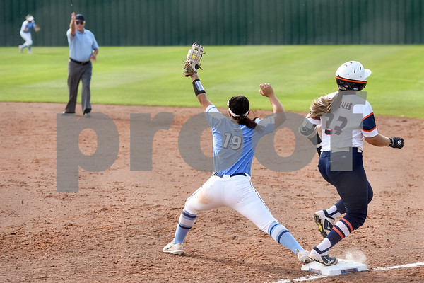 East Texas Baptist University's Sabrina Salts (19) catches the ball at first base and gets UT Tyler's Theresa Gonzales (23) out during a college softball game at the University of Texas at Tyler in Tyler, Texas, on Friday, April 6, 2018. (Chelsea Purgahn/Tyler Morning Telegraph)
