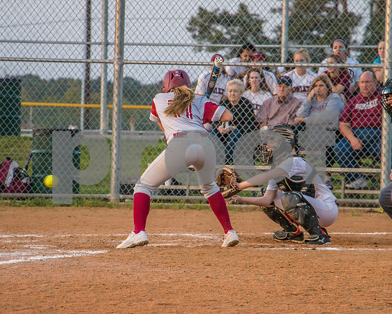 Lady Raiders catcher is pitched the ball by Makenna up against Rowlett.