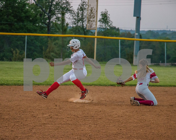 Deasia Gilbert just barely makes it to second plate beofre being tagged by Jones from Rowlett.