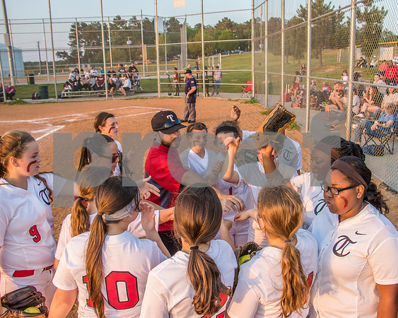 Robert E Lee lady raiders softball team rallying together as they go out to play at Faulkner park.