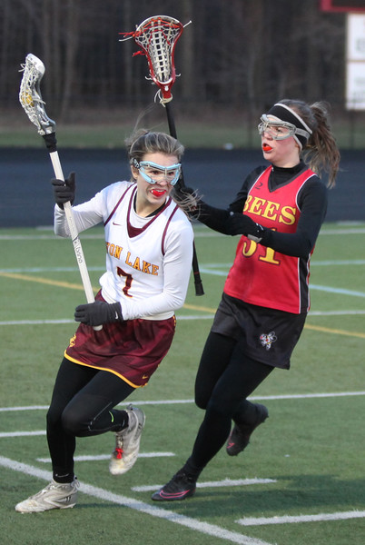 Liv MacDonald of Avon Lake runs the ball past Elaina Walcutt of Brecksville - Broadview Heights near the sideline. Randy Meyers -- The Morning Journal