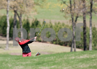 photo by Sarah A. Miller/Tyler Morning Telegraph  Robert E. Lee High School sophomore golfer Cole Wilkins drives the ball down the fairway of the sixth green Tuesday  during the 12-5A tournament at Twin Lakes Golf Course in Canton.