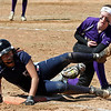 Lorain's Alexis Garcia dives back to first just before the tag by Maria Keller of Vermilion during the first game of a doubleheader. Randy Meyers -- The Morning Journal