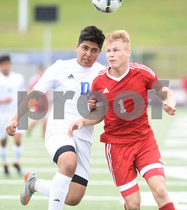 Henderson's Hector Salazar (10) and Kilgore's Spencer Stegall (1) collide as they both head the ball during their U.I.L. Region II Class 4-A tournament game against Henderson Saturday April 9, 2016 at Trinity Mother Frances Rose Stadium in Tyler.   (Sarah A. Miller/Tyler Morning Telegraph)