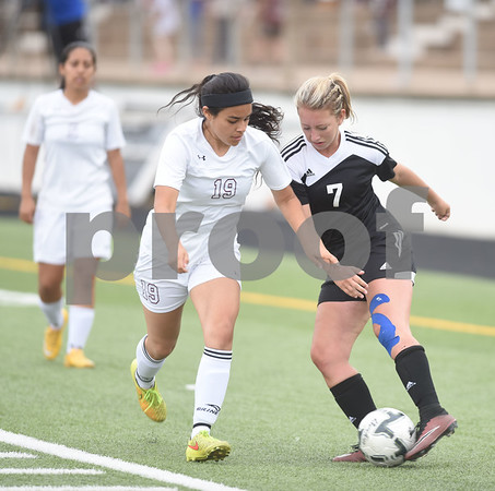 Kilgore's Leslie Bennett (7) keeps the ball from Athens' Samantha Banuelos (19) during their U.I.L. Region II Class 4-A soccer tournament game against Athens Saturday April 9, 2016 at Trinity Mother Frances Rose Stadium in Tyler. Kilgore won.  (Sarah A. Miller/Tyler Morning Telegraph)