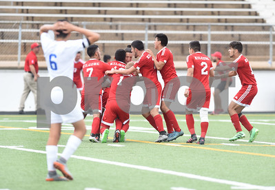 Henderson player Carlos Orta watches as the Kilgore High School boys' soccer team celebrate on the field after winning their U.I.L. Region II Class 4-A tournament game against Henderson Saturday April 9, 2016 at Trinity Mother Frances Rose Stadium in Tyler.   (Sarah A. Miller/Tyler Morning Telegraph)