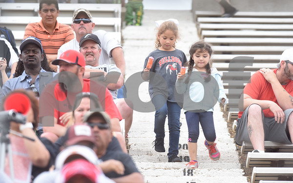 Little Kilgore soccer fans Jourdin Hudman, 6, and Camila Valenzuela, 5, walk down the bleachers with frozen snacks during the U.I.L. Region II Class 4-A soccer tournament game against Henderson Saturday April 9, 2016 at Trinity Mother Frances Rose Stadium in Tyler.   (Sarah A. Miller/Tyler Morning Telegraph)