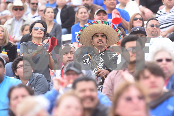Henderson soccer parents Cruz Orta and Carlos Orta play a cowbell and snare drum during the U.I.L. Region II Class 4-A soccer tournament game against Kilgore Saturday April 9, 2016 at Trinity Mother Frances Rose Stadium in Tyler.   (Sarah A. Miller/Tyler Morning Telegraph)