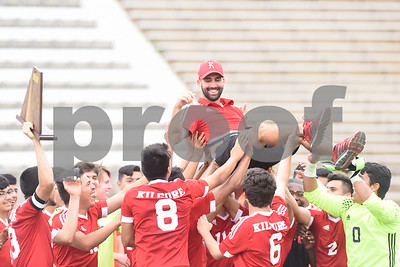 The Kilgore High School boys' soccer team lifts coach Austin Walker onto their shoulders as they celebrate on the field after winning their U.I.L. Region II Class 4-A tournament game against Henderson Saturday April 9, 2016 at Trinity Mother Frances Rose Stadium in Tyler.   (Sarah A. Miller/Tyler Morning Telegraph)