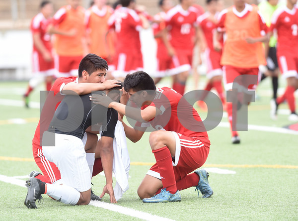 Two Kilgore High School boys' soccer team players stop celebrating to console a Henderson player who was visibly upset after the their U.I.L. Region II Class 4-A tournament game Saturday April 9, 2016 at Trinity Mother Frances Rose Stadium in Tyler. Kilgore beat Henderson, 2-1 in overtime.   (Sarah A. Miller/Tyler Morning Telegraph)