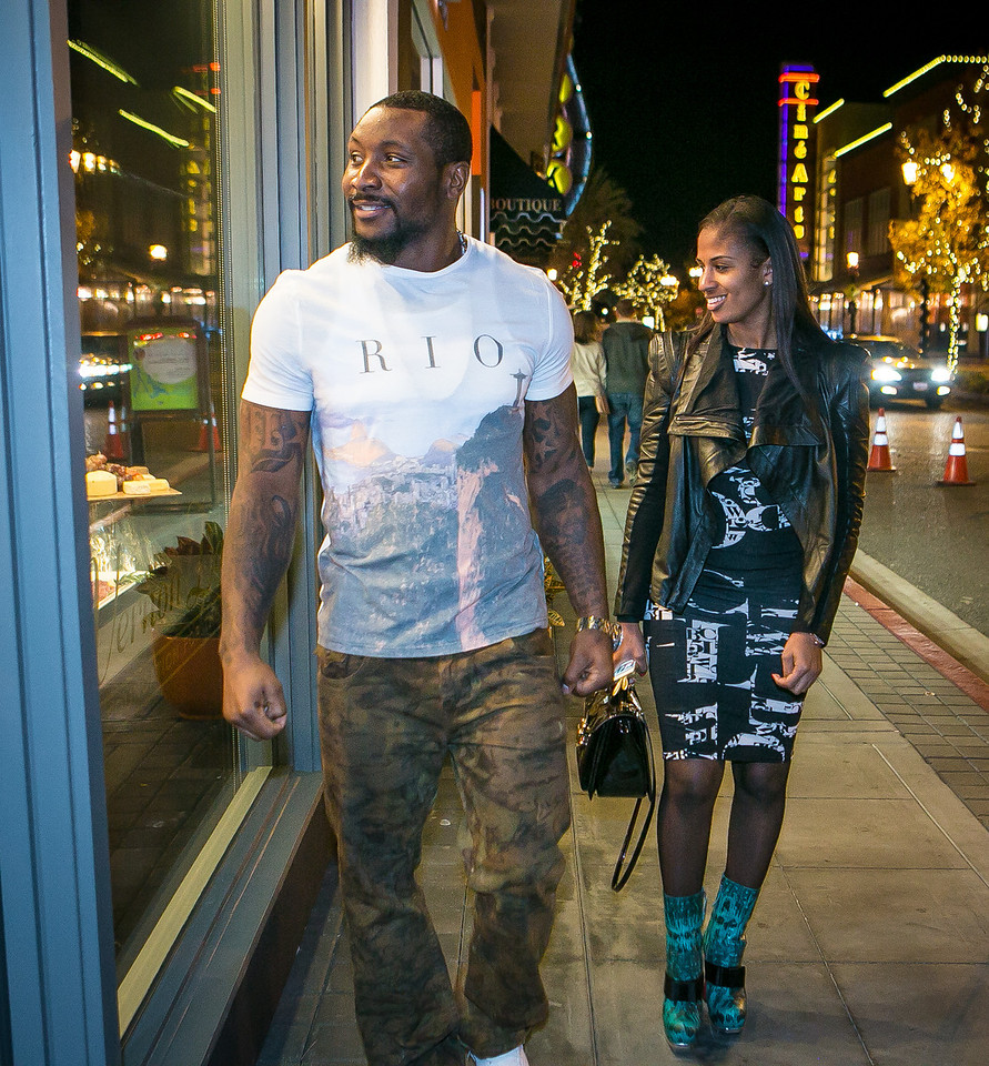 49ers linebacker NaVorro Bowman with Mikale Furguson walks into the grand opening of the Vernon Davis Gallery in Santana Row in San Jose on Monday, December 10th, 2012.