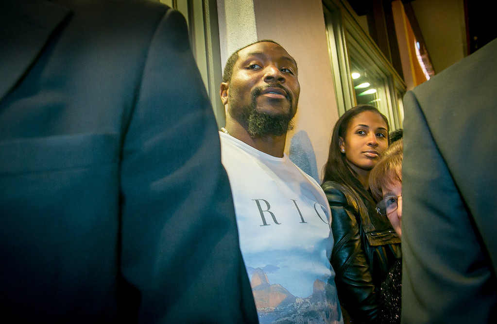 49ers linebacker NaVorro Bowman watches Vernon Davis arrive at the grand opening of the Vernon Davis Gallery in Santana Row in San Jose on Monday, December 10th, 2012.