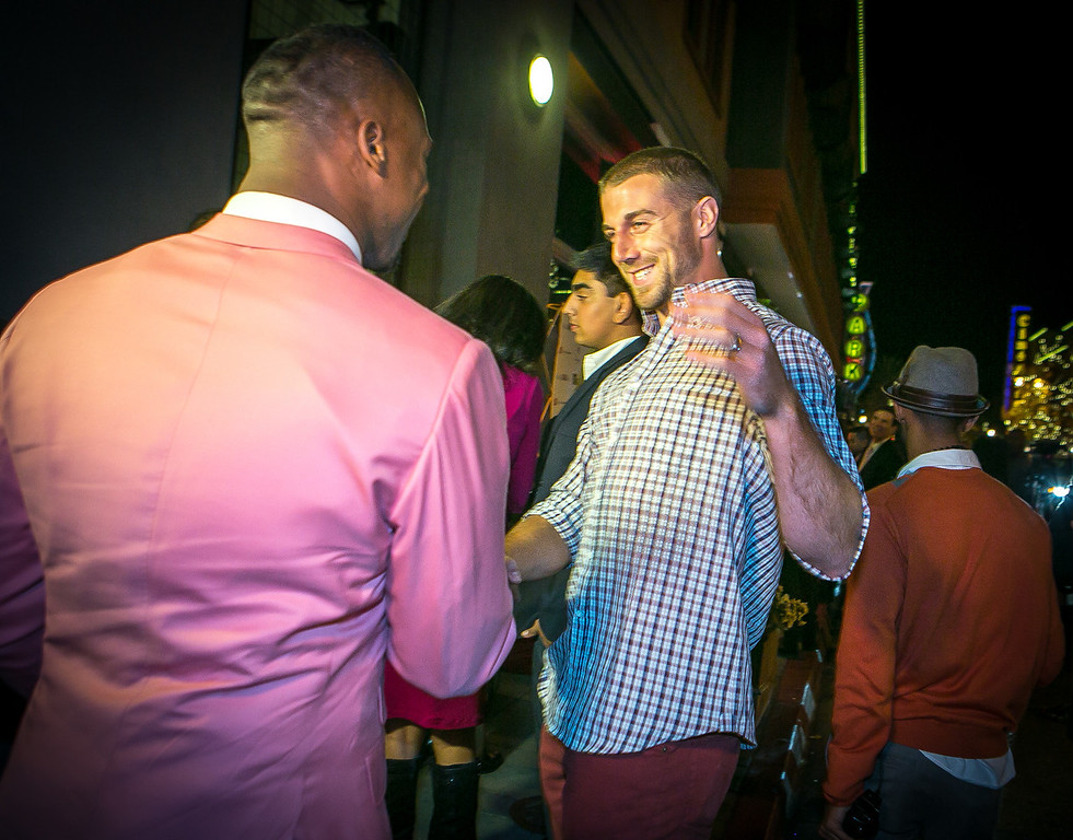 49ers quarterback Alex Smith greets Vernon Davis as he arrived at the grand opening of the Vernon Davis Gallery in Santana Row in San Jose on Monday, December 10th, 2012.