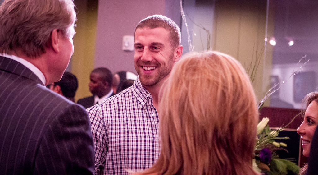 49es quarterback Alex Smith talks with guests at the grand opening of the Vernon Davis Gallery in Santana Row in San Jose on Monday, December 10th, 2012.