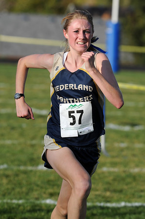 """Kelley Robinson of Nederland wins the 2A cross country regionals in Lyons on Thursday.<br /> For more photos of the races, go to  <a href=""""http://www.dailycamera.com"""">http://www.dailycamera.com</a><br /> Cliff Grassmick / October 21, 2010"""
