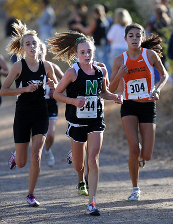 "Elise Cranny, center, of Niwot, wins the 4A regional race in Lyons.<br /> For more photos of the races, go to  <a href=""http://www.dailycamera.com"">http://www.dailycamera.com</a><br /> Cliff Grassmick / October 21, 2010"