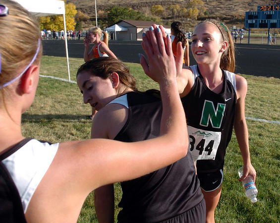 "Elise Cranny, right, of Niwot,  in congratulated by teammates after winning the 4A regional race in Lyons.<br /> For more photos of the races, go to  <a href=""http://www.dailycamera.com"">http://www.dailycamera.com</a><br /> For more photos of the races, go to  <a href=""http://www.dailycamera.com"">http://www.dailycamera.com</a><br /> Cliff Grassmick / October 21, 2010"