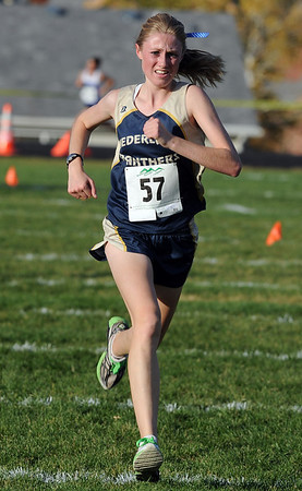 "Kelley Robinson of Nederland wins the 2A cross country regionals in Lyons on Thursday.<br /> For more photos of the races, go to  <a href=""http://www.dailycamera.com"">http://www.dailycamera.com</a><br /> Cliff Grassmick / October 21, 2010"