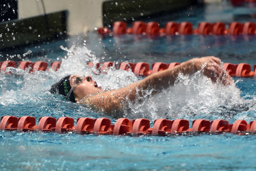 . Abigail Shaw, of Niwot, competes in the 100 yard backstrokeat Colorado 4A Girls State Swimming in Thornton on Saturday.  For more photos, go to BoCoPreps.com.  Cliff Grassmick / Staff Photographer/ February 10, 2018