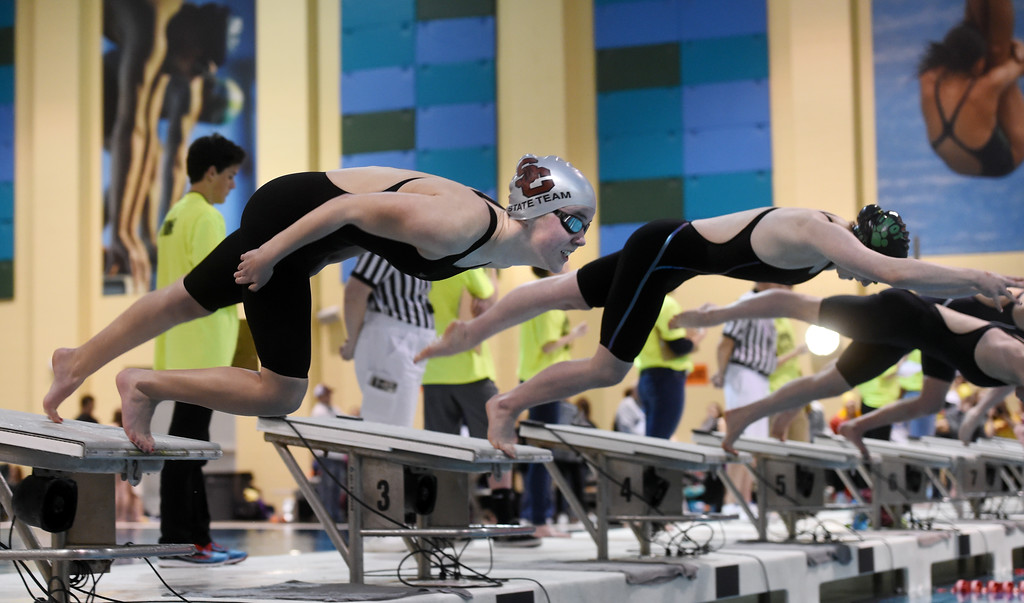. Emma Hermeston, left, of Silver Creek, and Peyten Irwin, of Niwot, in the 100 butterfly at Colorado 4A Girls State Swimming in Thornton on Saturday.  For more photos, go to BoCoPreps.com.  Cliff Grassmick / Staff Photographer/ February 10, 2018