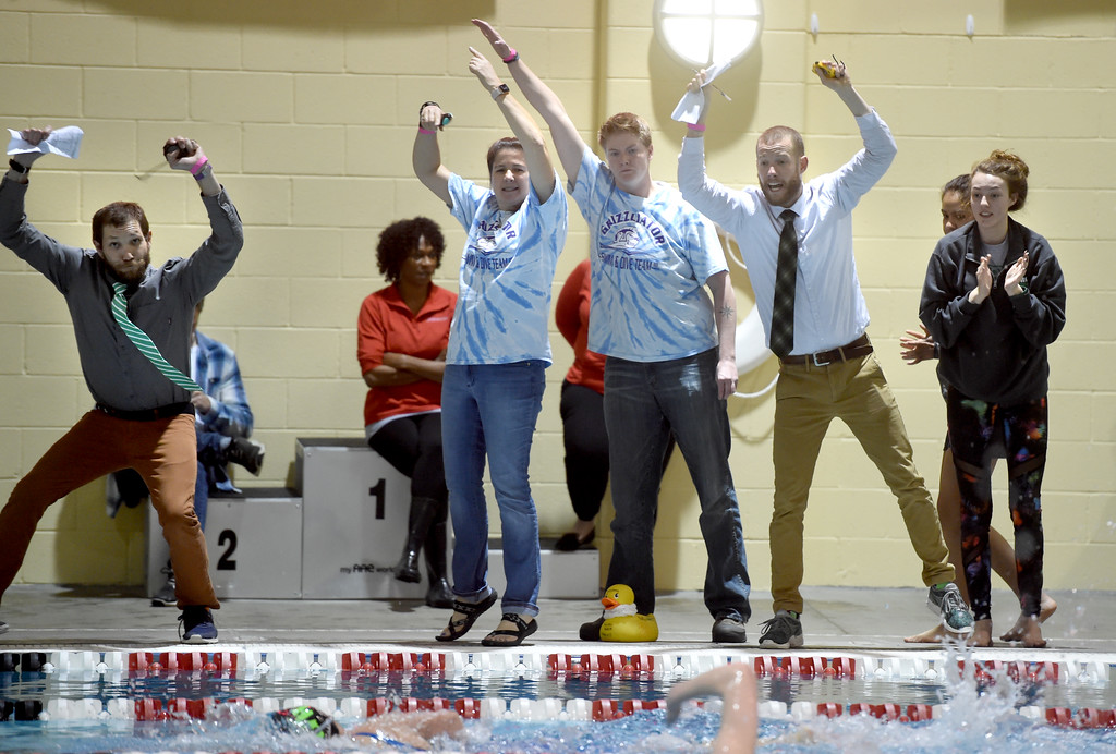 . Andrew Harbuck, left, a coach at George Washington, joins other coaches encouraging their swimmers at Colorado 4A Girls State Swimming in Thornton on Saturday.  For more photos, go to BoCoPreps.com.  Cliff Grassmick / Staff Photographer/ February 10, 2018