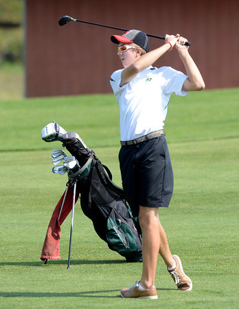 Niwot High School's Samuel Toillion hits a fairway iron at the 4A Northern Regionals at the Indian Peaks Golf Course on Wednesday September 19, 2012. <br /> Photo by Paul Aiken