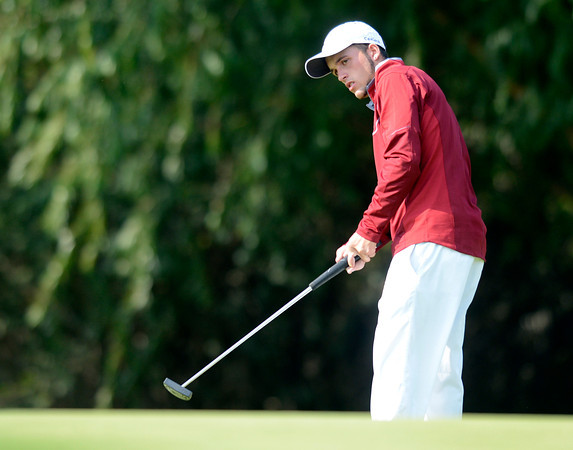 Windsor High School's Justin Carlock follows a putt at the 4A Northern Regionals at the Indian Peaks Golf Course on Wednesday September 19, 2012. <br /> Photo by Paul Aiken