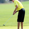 Thompson Valley High School's Zack Dwyer follows his putt at the <br /> 4A Northern Regionals at the Indian Peaks Golf Course on Wednesday September 19, 2012. <br /> Photo by Paul Aiken