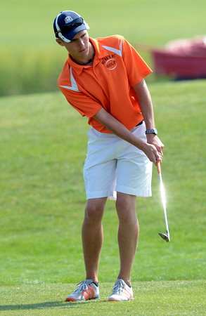Erie High School's Dalton Anderson chips onto a green at the 4A Northern Regionals at the Indian Peaks Golf Course on Wednesday September 19, 2012. <br /> Photo by Paul Aiken