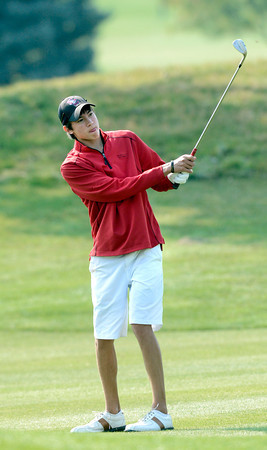 Silver Creek High School's Jack Adolfson hits a fairway iron at the<br /> 4A Northern Regionals at the Indian Peaks Golf Course on Wednesday September 19, 2012. <br /> Photo by Paul Aiken