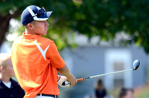 Erie High School's Dalton Anderson follows a drive at the 4A Northern Regionals at the Indian Peaks Golf Course on Wednesday September 19, 2012. <br /> Photo by Paul Aiken