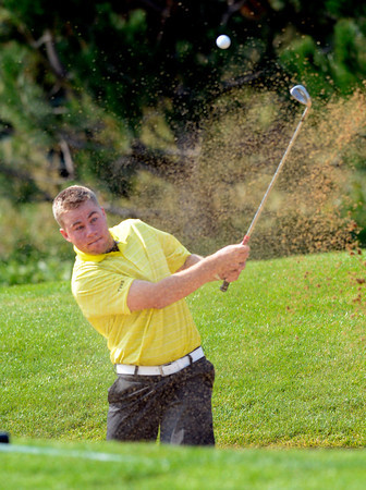 Thompson Valley High's Josh McLaughlin hits out of a sand trap at the<br /> 4A Northern Regionals at the Indian Peaks Golf Course on Wednesday September 19, 2012. <br /> Photo by Paul Aiken