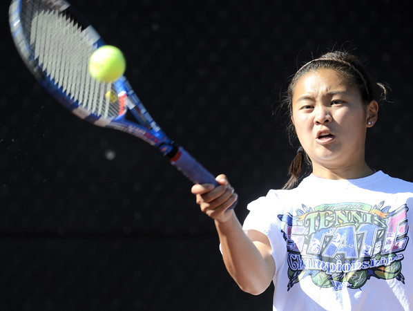 Fairview's Monic Li returns the ball to Douglas County's Kim Kern during her match in the 5A State Tennis Tournament in Denver, Colorado May 10, 2012. CAMERA/ MARK Leffingwell