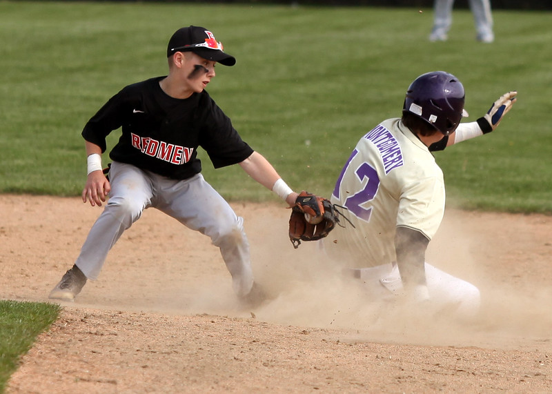 Vermilion's Mason Montgomerty beats the tag at second base by Caden Lance of Fostoria. Randy Meyers -- The Morning Journal
