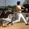 Reese Miller of Vermilion delivers a base hit against Fostoria. Randy Meyers -- The Morning Journal