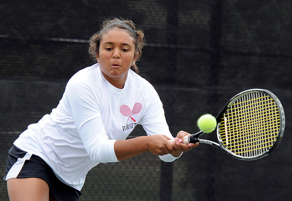 """Fairview High School's Hannah Embree returns the ball during the Girls class 5A #4 doubles championship match against Cherry Creek on Friday, May 11, at the Gates Tennis Center in Denver. For more photos of the matches go to  <a href=""""http://www.dailycamera.com"""">http://www.dailycamera.com</a><br /> Jeremy Papasso/ Camera"""