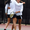 "Fairview High School's Sonia Ghosh hugs teammate Hannah Embree after scoring a point during the Girls class 5A #4 doubles championship match against Cherry Creek on Friday, May 11, at the Gates Tennis Center in Denver. For more photos of the matches go to  <a href=""http://www.dailycamera.com"">http://www.dailycamera.com</a><br /> Jeremy Papasso/ Camera"