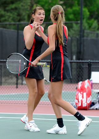 """Fairview High School's Paris Hogan, left, high-fives teammate Megan Thayer after scoring a point during the Girls class 5A #1 doubles championship match against Cherry Creek on Friday, May 11, at the Gates Tennis Center in Denver. For more photos of the matches go to  <a href=""""http://www.dailycamera.com"""">http://www.dailycamera.com</a><br /> Jeremy Papasso/ Camera"""