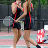 "Fairview High School's Paris Hogan, left, high-fives teammate Megan Thayer after scoring a point during the Girls class 5A #1 doubles championship match against Cherry Creek on Friday, May 11, at the Gates Tennis Center in Denver. For more photos of the matches go to  <a href=""http://www.dailycamera.com"">http://www.dailycamera.com</a><br /> Jeremy Papasso/ Camera"