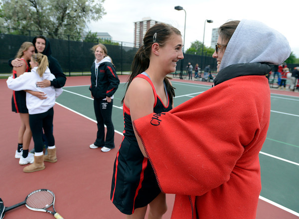 "Fairview High School's Megan Moore, right, hugs Paris Hogan while others hug Megan Thayer after Hogan and Thayer defeated Cherry Creek during the Girls class 5A #1 doubles championship match on Friday, May 11, at the Gates Tennis Center in Denver. For more photos of the matches go to  <a href=""http://www.dailycamera.com"">http://www.dailycamera.com</a><br /> Jeremy Papasso/ Camera"